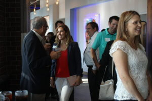 Chamber members network at an Ankeny Business After Hours event.