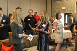 Members talk and greet one another during a chamber membership luncheon.