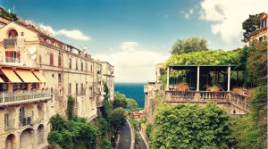 A photo of old buildings on the coast of Italy.