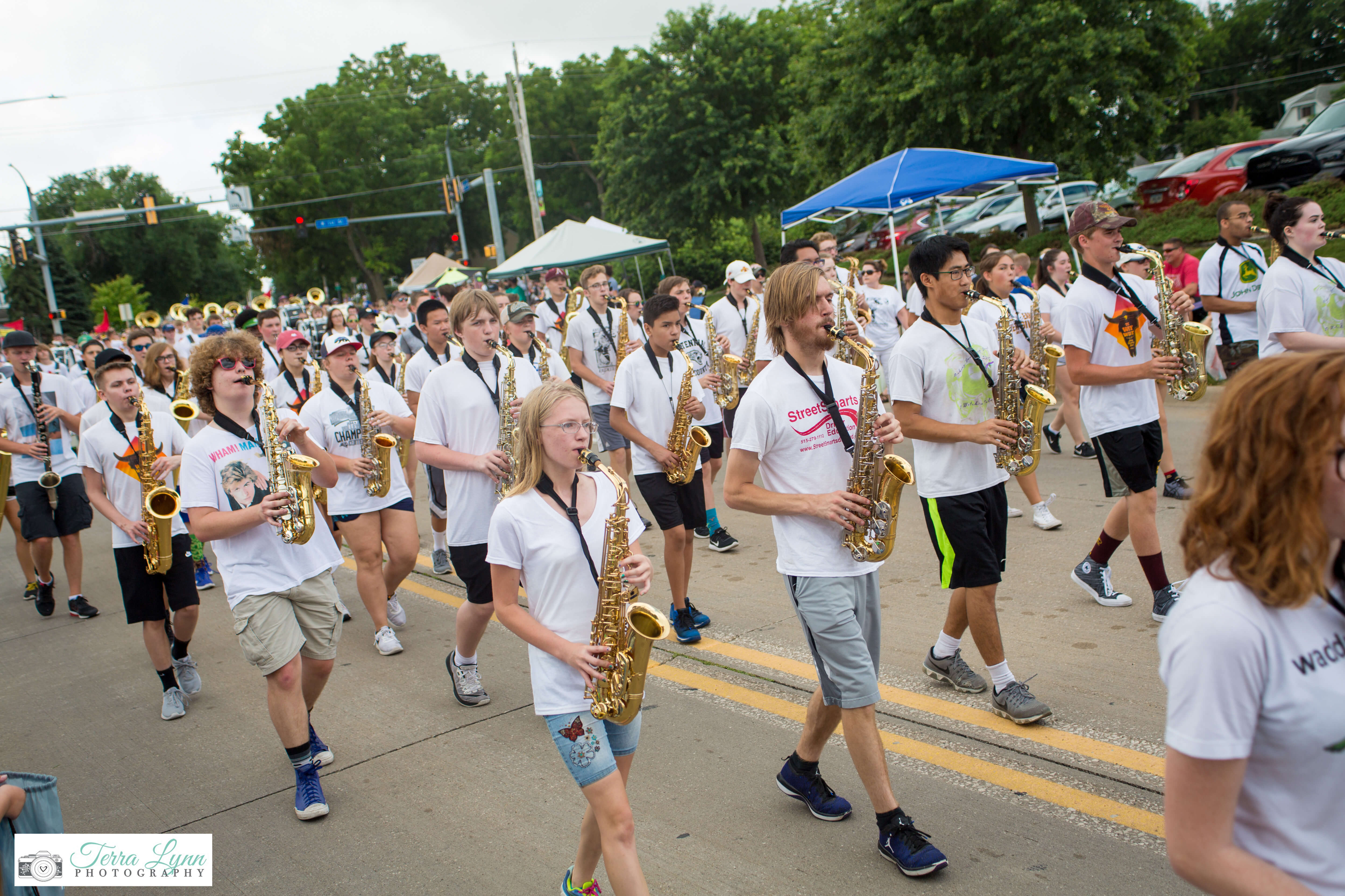 High school saxophone players march in step at the Grand Parade.