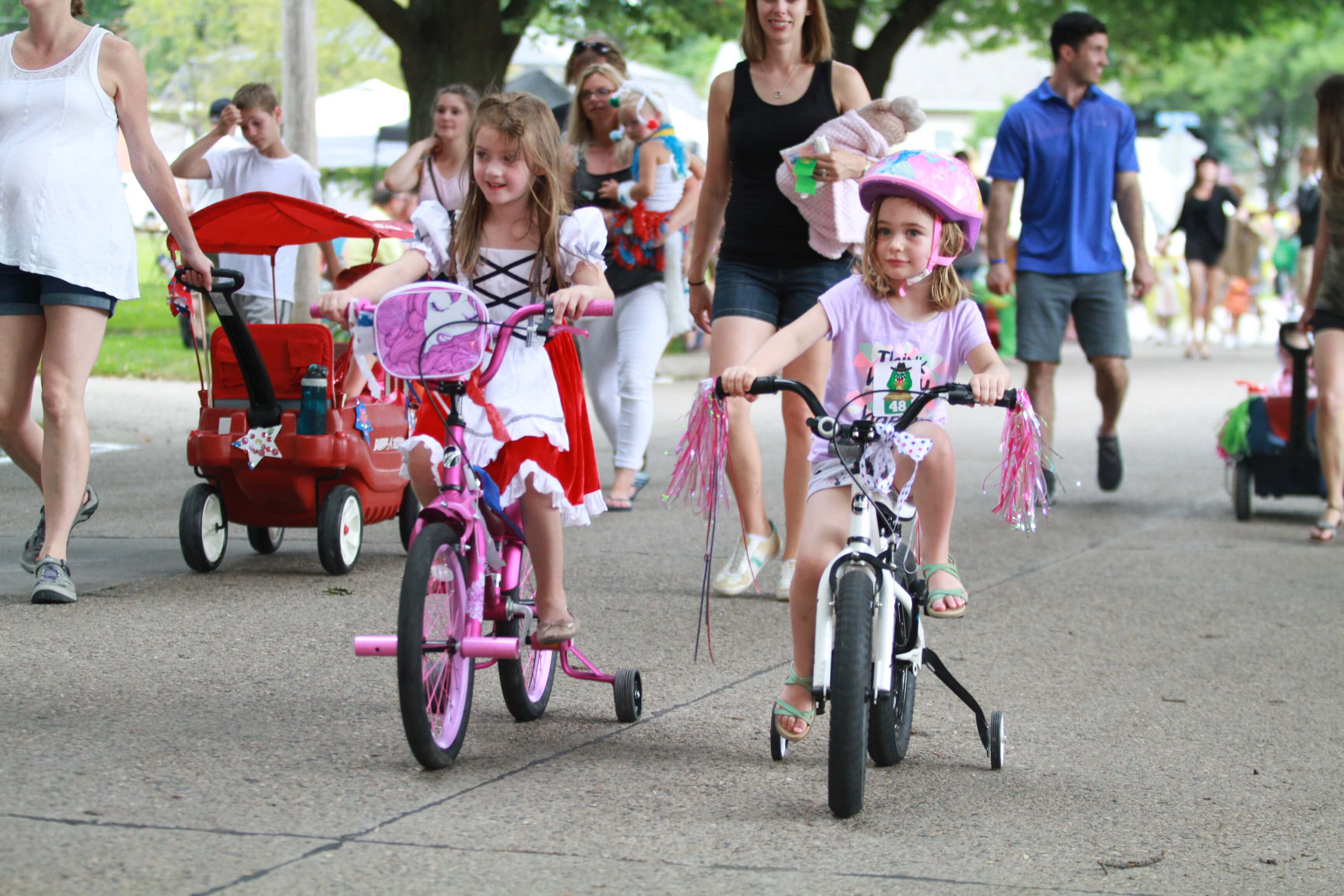 Two girls participate on bikes in the Kiddie Parade.