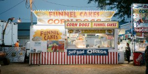 A photo of a Funnel Cake food stand at a fair.